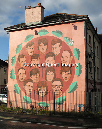 A mural called &quot;Bloody Sunday Memorial&quot; portraits of the 14 people who were killed by the British Army on 'Bloody Sunday' displayed on the side of an apartment complex called the Rossville Flats  in the Bogside, a neighborhood outside the city walls of Derry, Northern Ireland.<br />