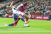 12th September 2017, Villa Park, Birmingham, England; EFL Championship football, Aston Villa versus Middlesbrough; Cyrus Christie of Middlesbrough tackles Albert Adomah of Aston Villa to clear the ball