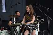 HAIM - drummer Dash Hutton and Alana Haim - performing live on the Pyramid Stage on Day One at the 2013 Glastonbury Festival held at Pilton Farm Pilton Somerset UK - 28 Jun 2013.  Photo credit: George Chin/IconicPix