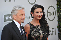 Michael Douglas &amp; Catherine Zeta-Jones at the 2014 American Film Institute's Life Achievement Awards honoring Jane Fonda, at the Dolby Theatre, Hollywood.<br /> June 5, 2014  Los Angeles, CA<br /> Picture: Paul Smith / Featureflash