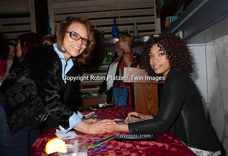 "a fan and Tia Dionne Hodge-Jones, who was on One Life to Live, at her book signing party on May 29, 2014 at Tryp by Wyndham Times Square South in New York City, New York, USA. The Book is called ""Play. Speak. Modern Monologues for the Modern Young Actor""."