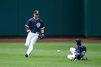 Columbus Clippers right fielder Tyler Naquin (6) fields a ball as second baseman Yhoxian Medina (15) slides to avoid a collision during a game against the Lehigh Valley IronPigs on May 12, 2016 at Huntington Park in Columbus, Ohio.  Lehigh Valley defeated Columbus 2-1.  (Mike Janes/Four Seam Images)