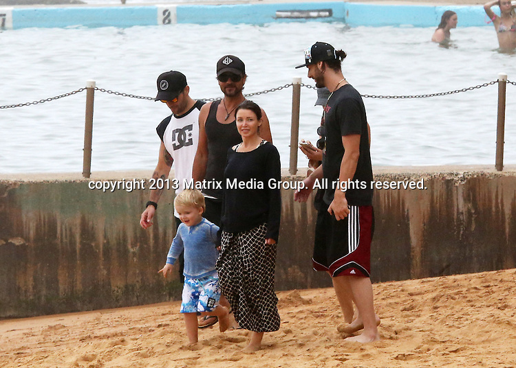 3 JANUARY 2014 SYDNEY AUSTRALIA<br /> <br /> EXCLUSIVE PICTURES<br /> <br /> Danni Minogue pictured with her new boyfriend and son Ethan enjoying an afternoon at Bilgola Beach with friends.<br /> <br /> <br /> *No internet without clearance*<br /> MUST CALL PRIOR TO USE .<br /> +61 2 9211-1088<br /> Matrix Media Group<br /> Note: All editorial images subject to the following: For editorial use only. Additional clearance required for commercial, wireless, internet or promotional use.Images may not be altered or modified. Matrix Media Group makes no representations or warranties regarding names, trademarks or logos appearing in the images.