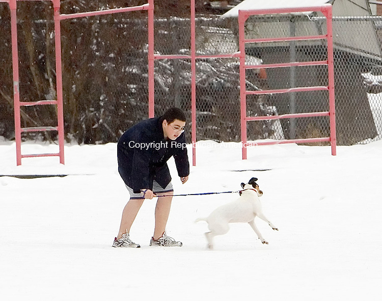 WATERBURY, CT- 01 JAN 2008- 010108JT02-<br /> Collin Murphy, 12, takes his fox terrier Roxie out to play at Sanford Avenue Field in Thomaston on Tuesday, New Year's Day.<br /> Josalee Thrift / Republican-American