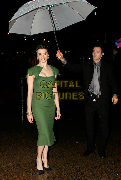 "RACHEL WEISZ.London Film Festival UK Premiere of ""The Constant Gardener"", opening night gala, London, UK..October 19th, 2005.Ref: AH.full length green dress umbrella.www.capitalpictures.com.sales@capitalpictures.com.© Capital Pictures."
