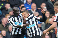 Mohamed Diame (left) congratulates teammates Dwight Gayle of Newcastle United on his goal 1 0 during the Premier League match between Chelsea and Newcastle United at Stamford Bridge, London, England on 2 December 2017. Photo by David Horn.