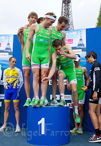 09 JUL 2011 - PARIS, FRA - Jonathan Brownlee attempts to join his EC Sartrouville team mates on the podium after they won the third men's French Grand Prix series race (PHOTO (C) NIGEL FARROW)
