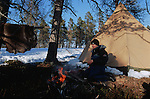 It is time to establish our camp base. Set up the lavvu -a kind of huge tepee-, look for some wood, make a hole in the ice to get the water, prepare the meal... Ancestral movements repeated for centuries by the Sami..Reindeer migration from Gallivare to the national parks of  Sarek and Stora Sjôfallet, 200 km west. Lapland, Sapmi, north of Sweden..