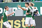 March 3, 2013; Portland, OR, USA; Portland Timbers midfielder Diego Valeri (8) celebrates with teammates after scoring the Timbers' first goal against New York Red Bulls to tie the game 1-1 in the first half at Jeld-Wen Field.  Mandatory Credit: Jaime Valdez-USA TODAY Sports
