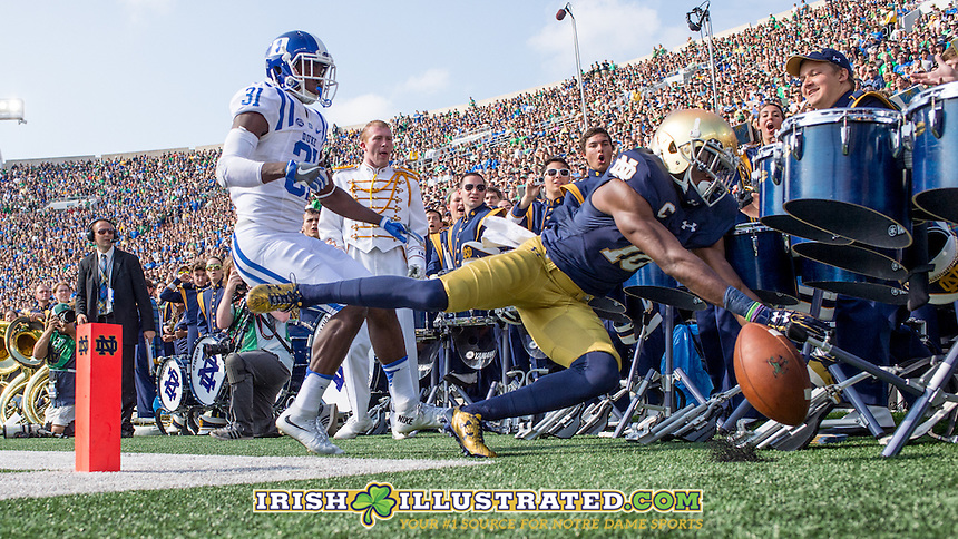 Wide receiver Torii Hunter Jr. (16) ends up in the ND Band after an overthrown TD toss.