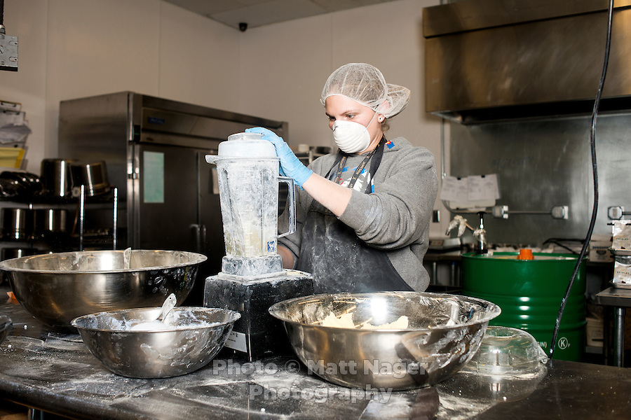 Chelsy Slater (cq), a production assistant, mixes a marijuana infused powder for an orange mint at the Dixie Elixir warehouse in Denver, Colorado, Thursday, December 18, 2014. Dixie Elixirs, LLC has been making premium carbonated medical marijuana drinks and medical marijuana edibles since 2009.<br /> <br /> Photo by Matt Nager