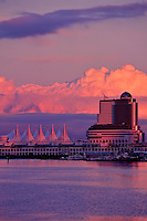Radiant sunset on Canada Place and the Pan Pacific Hotel after a storm passing, from the seawall in Coal Harbour, Stanley Park, Vancouver, BC.