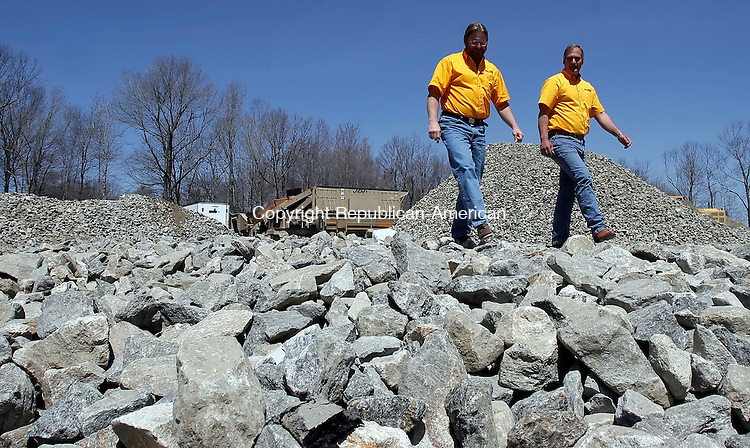 PLYMOUTH, CT-20 April 2006-042006TK13- (left to right:) John Coleman and Joel Kuczenski of Engineering Support International, L.L.C., inspect land being cleared in the Plymouth Buesiness Park for the construciton of a building designed for ESI and its incubator program.  Tom Kabelka Republican-American ((John Coleman and Joel Kuczenski)