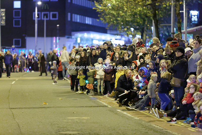 "Pictured: Locals gather on Princess Street to watch the Christmas parade in Swansea, Wales, UK. Sunday 19 November 2018<br /> Re: Swansea Christmas parade attended by thousands has been branded a ""shambles"" for having just three floats.<br /> The annual festive event in south Wales, which took place on Sunday, promised ""dynamic dance-troupes"" as well as ""spectacular shows and stages"".<br /> But the parade was scaled down, leading to a barrage of criticism on social media because of roadworks in the city centre. <br /> The leader of Swansea Council, Rob Stewart apologised on Facebook and said the parade was not ""good enough"".<br /> Parents took on social media to voice their anger, calling the event ""a load of rubbish"" and claiming there was nothing for young children apart from ""a loud music float with Santa on""."