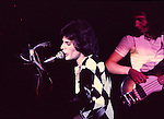 Queen 1975 Freddie Mercury and John Deacon..© Chris Walter..