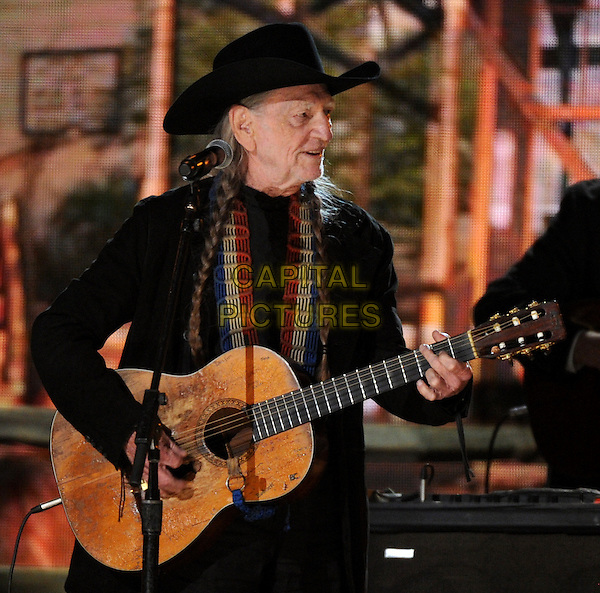 LOS ANGELES, CA - JANUARY 26 : Willie Nelson performs onstage at The 56th Annual GRAMMY Awards at Staples Center on January 26, 2014 in Los Angeles, California.<br /> CAP/MPI/PG<br /> &copy;PGFMicelotta/MediaPunch/Capital Pictures