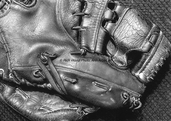 B&W closeup of a well-worn baseball glove owned by Bob