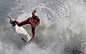 Tournament winner Courtney Conlogue, 24, of Santa Ana, pulls off a 180 degree turn off the lip of a wave during the final heat of the Paul Mitchell Neon Supergirl Surf Pro tournament in Oceanside Sunday. She had won the tournament one time before. photo by Bill Wechter