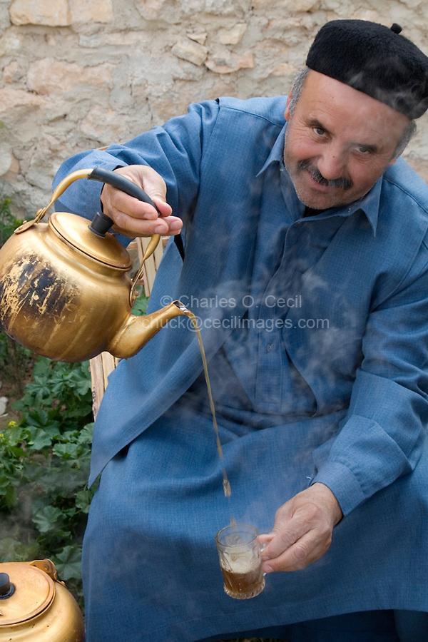 Kabaw, Libya - Libyan Pouring Tea, Wearing Tunisian Chechia (Hat)