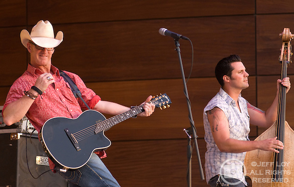 Two Tons of Steel lead singer Kevin Geil (left) and bass player Chris Rhoades perform at the Levitt Pavilion in Arlington, Texas June 6,2010.