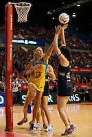 20.10.2015 Silver Ferns Bailey Mes and Australia's Laura Geitz in action during the Silver Ferns v Australian Diamonds netball test match played ay Horncastle Arena in Christchruch. Mandatory Photo Credit ©Michael Bradley.