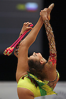 Evgenia Kanaeva of Russia balances with clubs (leg behind) at 2008 Portimao World Cup of Rhythmic Gymnastics on April 20, 2008.  Photo by Tom Theobald.