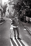 TURKEY, Istanbul, a man and his daughter stand in the street in front of their home near the Blue Mosque (B&W)