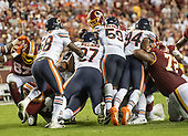 Washington Redskins quarterback Case Keenum (8) tries to jump for a first down on fourth and one in the fourth quarter against the Washington Redskins at FedEx Field in Landover, Maryland on Monday, September 23, 2019.  Defending on the play are Chicago Bears inside linebacker Roquan Smith (58), defensive tackle Nick Williams (97), inside linebacker Danny Trevathan (59), and outside linebacker Leonard Floyd (94).  Washington Redskins blocking on the play include tight end Jeremy Sprinkle (87) and offensive tackle Donald Penn (72)<br /> Credit: Ron Sachs / CNP
