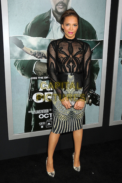 "Carmen Ejogo.""Alex Cross"" Los Angeles Premiere held at the Arclight Cinerama Dome, Hollywood, California, USA..October 15th, 2012.full length top skirt stripe yellow print pattern clutch bag black sheer  .CAP/ADM/BP.©Byron Purvis/AdMedia/Capital Pictures."