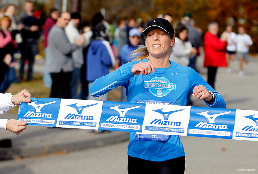 Megan Parker of Portsmouth comes in first in the women's division of the Seacoast Half-Marathon road race in Portsmouth, N.H. Sunday, Nov. 14,  2010.  (Portsmouth Herald Photo Cheryl Senter)