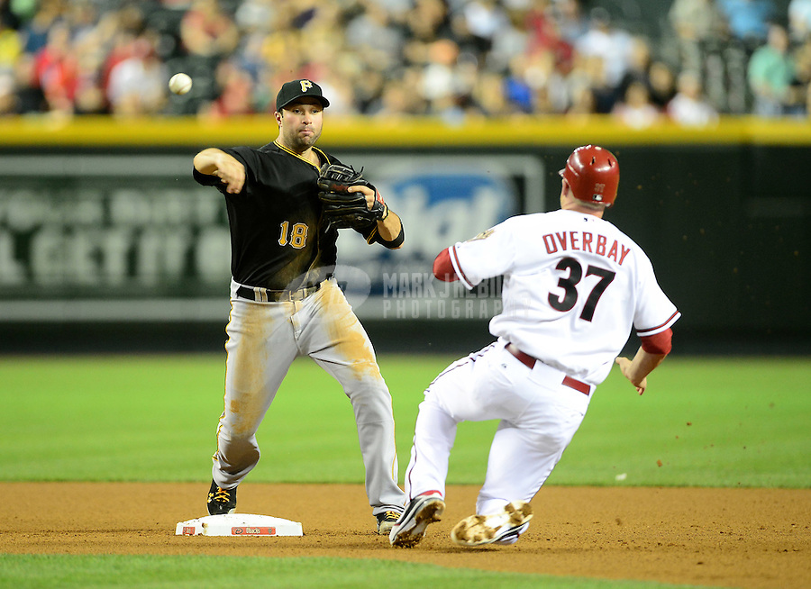 Apr. 17, 2012; Phoenix, AZ, USA; Pittsburgh Pirates second baseman Neil Walker throws to first base to complete the double play after forcing out Arizona Diamondbacks base runner Lyle Overbay in the fourth inning at Chase Field. Mandatory Credit: Mark J. Rebilas-