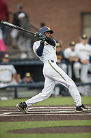Michigan Wolverines outfielder Johnny Slater (25) follows through on his swing against the Michigan State Spartans on May 19, 2017 at Ray Fisher Stadium in Ann Arbor, Michigan. Michigan defeated Michigan State 11-6. (Andrew Woolley/Four Seam Images)