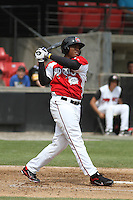 Carolina Mudcats outfielder Carlos Moncrief #20 at bat during a game against the Lynchburg Hillcats at Five County Stadium on April 26, 2012 in Zebulon, North Carolina. Carolina defeated Lynchburg by the score of 8-5. (Robert Gurganus/Four Seam Images)