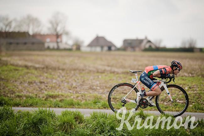"Hiroki Nishimura (JAP/Nippo Vini Fantini Faizanè) attempting a ""Froomey"" escape from the peloton<br /> <br /> 74th Nokere Koerse 2019 <br /> One day race from Deinze to Nokere / BEL (196km)<br /> <br /> ©kramon"
