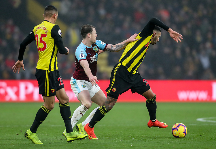 Burnley's Ashley Barnes competing with Watford's Etienne Capoue<br /> <br /> Photographer Andrew Kearns/CameraSport<br /> <br /> The Premier League - Watford v Burnley - Saturday 19 January 2019 - Vicarage Road - Watford<br /> <br /> World Copyright &copy; 2019 CameraSport. All rights reserved. 43 Linden Ave. Countesthorpe. Leicester. England. LE8 5PG - Tel: +44 (0) 116 277 4147 - admin@camerasport.com - www.camerasport.com