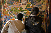 Thangka Painters -  A thangka is a painted or embroidered Buddhist banner which is hung in a monastery or a family altar and occasionally carried by monks in ceremonial processions. Sometimes a thangka is called a scroll painting.  Originally, thangka painting became popular among traveling monks because the scroll paintings were easily rolled and transported from monastery to monastery. These thangka served as important teaching tools depicting the life of the Buddha, various influential lamas and other deities and bodhisattvas. One popular subject is The Wheel of Life.