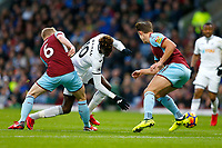 Tammy Abraham of Swansea City is tackled by Ben Mee of Burnley during the Premier League match between Burnley and Swansea City at Turf Moor, Burnley, England, UK. Saturday 18 November 2017