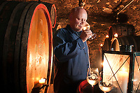 Rudesheim am Rhein, Hessen, Germany, July 2010. Wine tasting in the cellar at the Weingut Jakob Scholl Nachfolger wine estate next to the Zur Lindenau restaurant. Rüdesheim is a winemaking town in the Rhine Gorge and thereby part of the UNESCO World Heritage Site. The fertile river valleys and the rolling hills form the basis for some of Germany's best wines.  Photo by Frits Meyst / Adventure4ever.com