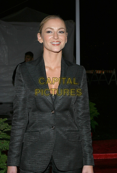 DREA DE MATTEO.31st Annual People's Choice Awards held at the Pasadena Civic Auditorium. .January 9th, 2004.Photo Credit: Jacqui Wong/AdMedia..half length, black suit jacket, plunging neckline.www.capitalpictures.com.sales@capitalpictures.com.© Capital Pictures.