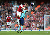 9th September 2017, Emirates Stadium, London, England; EPL Premier League Football, Arsenal versus Bournemouth; Nacho Monreal of Arsenal beats Joshua King of Bournemouth to head the ball out