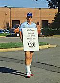 Washington Redskins quarterback Jay Schroeder walks the picket line outside Redskins Park in Herndon, Virginia on September 22, 1987, the first day of the NFL players strike.<br /> Credit: Howard L. Sachs / CNP