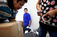 leaving0627 Luis Sanchez, Jr. 13, watches as his dad Luis Sanchez, 33, (CQ) and mom Marlen Ramirez, 33, pack a box while preparing to move from Arizona to Pennsylvania to flee Arizona's new tough immigration law. Both Luis Sr. and Marlen are in the country illegally. (Pat Shannahan/ The Arizona Republic)