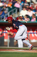 Peoria Chiefs shortstop Oscar Mercado (4) runs to first during a game against the Lansing Lugnuts on June 6, 2015 at Cooley Law School Stadium in Lansing, Michigan.  Lansing defeated Peoria 6-2.  (Mike Janes/Four Seam Images)