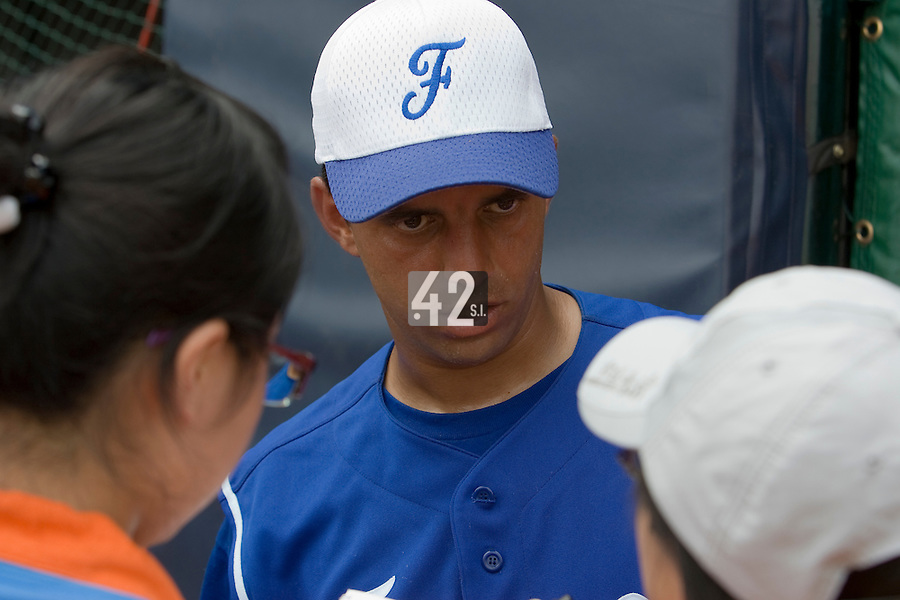 18 August 2007: Catcher #26 Jamel Boutagra answers journalists during the China 5-1 victory over France in the Good Luck Beijing International baseball tournament (olympic test event) at the Wukesong Baseball Field in Beijing, China.
