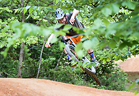 """Rich Drew jumps his bike over a hill, Thursday, May 21, 2020 at Slaughter Pen bike trail in Bentonville. <br /> <br /> Rich Drew, founder of the Rider Series MTB Skills Clinic, filmed an episode of his Youtube channel, Richdrew, where he provides how-to tutorials on riding to his viewers. <br /> <br /> He started the channel in January before the pandemic sent the country into lockdown, shuttering his ride series for two months. <br /> <br /> The shutdown gave him the opportunity to pivot harder towards his channel, which started at about 1,900 viewers, ballooning to 22.6 thousand. <br /> <br /> """"It was tough for me because that was my family's main revenue source. Thankfully, they're coming back,"""" he said of his class regulars. Saturday will be his second class since jumpstarting his in-person series again.<br /> <br /> He will hold his second class, MTB 101 Fundamentals, on Saturday from 8am to noon and 1pm to 5pm at a field in Memorial Park behind the basketball courts. He said they will adhere to CDC guidelines of social distancing. Check out nwaonline.com/200522Daily/ for today's photo gallery. <br /> (NWA Democrat-Gazette/Charlie Kaijo)"""