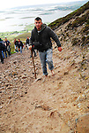 Terrance McDonagh from Ballymote Co Sligo makes his way barefotted up Croagh Patrick on reek sunday...Pic Conor McKeown