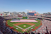 Two FA/18 Hornets fly over Nationals Park in Washington, D.C. as part of the pre-game festivities prior to the New York Mets against the Washington Nationals game at Nationals Park in Washington, D.C. on Monday, April 6, 2015.<br /> Credit: Ron Sachs / CNP<br /> (RESTRICTION: NO New York or New Jersey Newspapers or newspapers within a 75 mile radius of New York City)