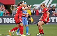 Portland, Oregon - Wednesday June 22, 2016: Portland Thorns FC forward Christine Sinclair (12) and forward Lindsey Horan (7) celebrate in front of Chicago Red Stars defender Julie Johnston (8) during a regular season National Women's Soccer League (NWSL) match at Providence Park.