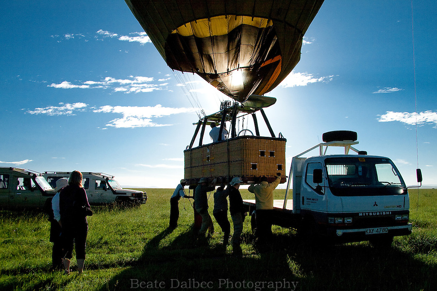 Loading the hot air balloon after a ride over the Masai Mara, Kenya