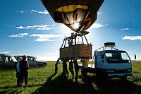Loading the hot air balloon after a ride over the Masai Mara, Kenya
